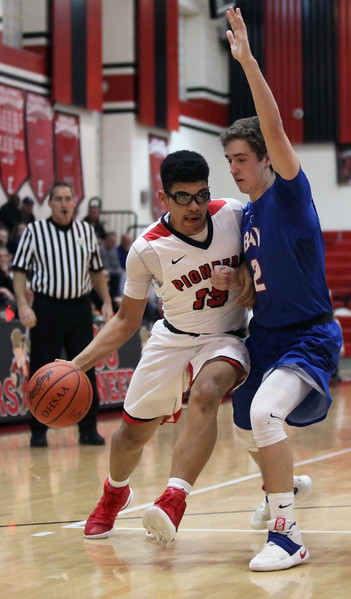 Elyria's Anthony Brown drives against Daniel Brajdic of Bay during the first quarter.  Randy Meyers -- The Morning Journal