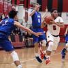 Elyria guard Dezman Brown drives through the Bay defense during the first quarter. Randy Meyers -- The Morning Journal
