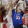 Bay's Christian Dupps puts up a shot over Josh Lotko of Elyria during the second quarter. Randy Meyers -- The Morning Journal