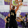 Boulder's Will Grubb (right) takes a shot over Rock Canyon's Jimmy Owsley (left) during their basketball game at Boulder High School in Boulder, Colorado December 5, 2011. CAMERA/Mark Leffingwell