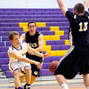 Boulder's Jack Huettel (left) passes the ball between Rock Canyon's Ben Finnerty (middle) and Josh Peterson (right) during their basketball game at Boulder High School in Boulder, Colorado December 5, 2011. CAMERA/Mark Leffingwell