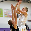 Boulder's Andrew Kurtz (right) shoots the ball over Rock Canyon's Brady McNeily (left) during their basketball game at Boulder High School in Boulder, Colorado December 5, 2011. CAMERA/Mark Leffingwell
