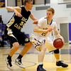 Boulder's Alex King (right) is guarded by Rock Canyon's Jordan Koslosky (left) during their basketball game at Boulder High School in Boulder, Colorado December 5, 2011. CAMERA/Mark Leffingwell