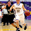 Boulder's Jack Huettel (right) drives toward the basket while being guarded by Rock Canyon's Ben Finnerty (left) during their basketball game at Boulder High School in Boulder, Colorado December 5, 2011. CAMERA/Mark Leffingwell
