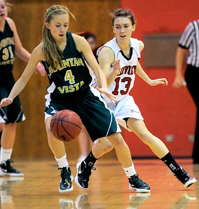 Fairview's Katie Kuosman (right) puts pressure on Mountain Vista's Karlee Schwartzkopf (left) during their basketball game at Fairview High School in Boulder, Colorado December 6, 2011. CAMERA/Mark Leffingwell