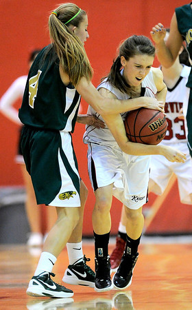 Fairview's Katie Kuosman (right) steals the ball from Mountain Vista's Karlee Schwartzkopf (left) during their basketball game at Fairview High School in Boulder, Colorado December 6, 2011. CAMERA/Mark Leffingwell