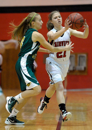 Fairview's Julia D'Amico (right) passes the ball away from Mountain Vista's Karlee Schwartzkopf (left) during their basketball game at Fairview High School in Boulder, Colorado December 6, 2011. CAMERA/Mark Leffingwell