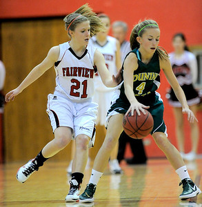 Fairview's Julia D'Amico (left) pressures Mountain Vista's Karlee Schwartzkopf (right) during their basketball game at Fairview High School in Boulder, Colorado December 6, 2011. CAMERA/Mark Leffingwell