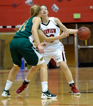 Fairview's Sarah Kaufman (right) passes the ball around Mountain Vista's Megan Whetstone (left) during their basketball game at Fairview High School in Boulder, Colorado December 6, 2011. CAMERA/Mark Leffingwell