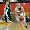Fairview's Hannah Hyde (right) passes the ball off under pressure from Mountain Vista's Kylie Klein (left) during their basketball game at Fairview High School in Boulder, Colorado December 6, 2011. CAMERA/Mark Leffingwell