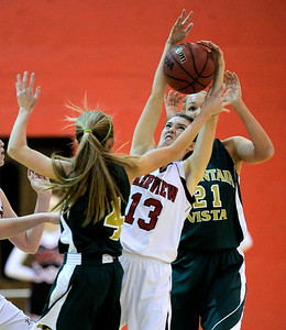 Fairview's Katie Kuosman (middle) fights Mountain Vista's Karlee Schwartzkopf (left) and Jennifer Wahleilthner (right) for the ball during their basketball game at Fairview High School in Boulder, Colorado December 6, 2011. CAMERA/Mark Leffingwell