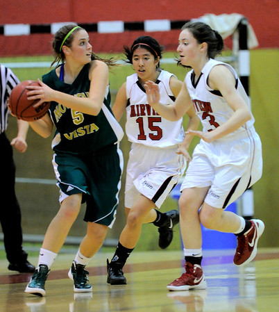 Fairview's Betti Yi (middle) and Sarah Kaufman block Mountain Vista's Maddy Whetstone (left) during their basketball game at Fairview High School in Boulder, Colorado December 6, 2011. CAMERA/Mark Leffingwell