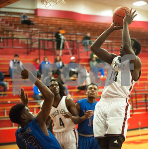 Robert E. Lee's (33) Dephen Walker shoots for the basket during their game against Lakeview Centennial High School Tuesday at home.  (Sarah A. Miller/Tyler Morning Telegraph)