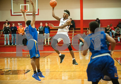Robert E. Lee's (11) Isjuwan Barker passes the basketball during their game against Lakeview Centennial High School Tuesday at home.  (Sarah A. Miller/Tyler Morning Telegraph)