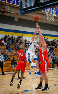 Brownsboro's Cole Williams (11) shoots a basket with Elysian Fields' Ja'Darryl Jones (10), left, and Justin Kitchen (34) try to block during their game in the Great East Texas Shootout in Brownsboro on Thursday Dec. 6, 2018.   (Sarah A. Miller/Tyler Morning Telegraph)