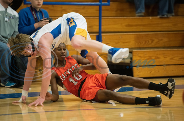 Brownsboro's Chance King (0) and Elysian Fields' Ja'Darryl Jones (10) tumble during their game in the Great East Texas Shootout in Brownsboro on Thursday Dec. 6, 2018.   (Sarah A. Miller/Tyler Morning Telegraph)
