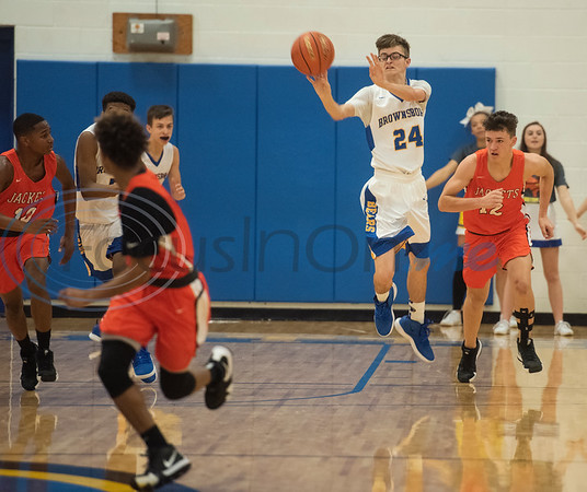 Brownsboro's Jacob Fitzgerald (24) passes the ball as the Bears play Elysian Fields in the Great East Texas Shootout in Brownsboro on Thursday Dec. 6, 2018.   (Sarah A. Miller/Tyler Morning Telegraph)