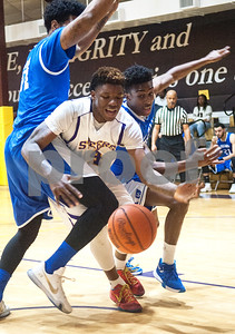 Texas College's Dezmond Biggurs loses control of the ball as he's sandwiched by Dillard University's Sean Burrell, left, and Kristian Clark, right, during their basketball game Wednesday night Jan. 27, 2016 at Gus F. Taylor Gymnasium.  (Sarah A. Miller/Tyler Morning Telegraph)