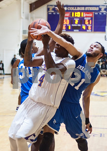 Texas College's Dezmond Biggurs is fouled by Dillard University's Dennis Reed during their basketball game Wednesday night Jan. 27, 2016 at Gus F. Taylor Gymnasium.  (Sarah A. Miller/Tyler Morning Telegraph)
