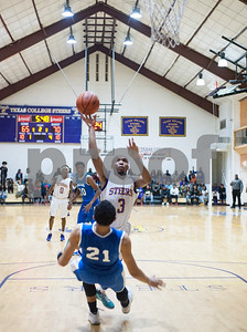 Texas College's Demarcus Bowie shoots the ball over Dillard University's Dennis Reed during their basketball game Wednesday night Jan. 27, 2016 at Gus F. Taylor Gymnasium.  (Sarah A. Miller/Tyler Morning Telegraph)