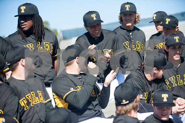 Tyler Junior College baseball players Travis Smith and Alex Masotto play a round of rock, paper, scissors while waiting for their teammates to arrive for their team photo Wednesday Jan. 27, 2016 during their media day at Mike Carter Field in Tyler.  (Sarah A. Miller/Tyler Morning Telegraph)