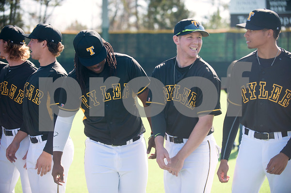 Tyler Junior College baseball players Jordan Trahan, Colton Whitehouse and AbeRee Hiebert stand in line as they wait to take their team photo Wednesday Jan. 27, 2016 during their media day at Mike Carter Field in Tyler.  (Sarah A. Miller/Tyler Morning Telegraph)