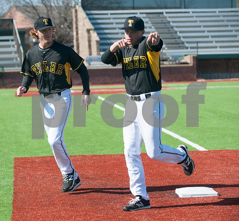 Tyler Junior College baseball players Jace Campbell and Sam Sitton run to get their places to take their team photo Wednesday Jan. 27, 2016 during their media day at Mike Carter Field in Tyler.  (Sarah A. Miller/Tyler Morning Telegraph)
