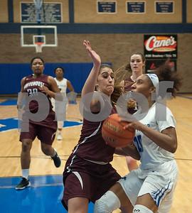 Whitehouse's Brittany Taylor tries to stop John Tyler's Shakendra Tilley at John Tyler High School Friday night Jan. 29, 2016.  (Sarah A. Miller/Tyler Morning Telegraph)