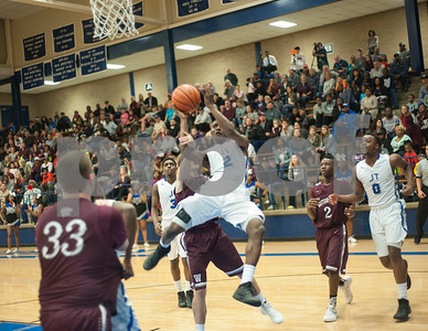 John Tyler's Bryson Smith shoots for a basket as they play Whitehouse Friday night Jan. 29, 2016.  (Sarah A. Miller/Tyler Morning Telegraph)