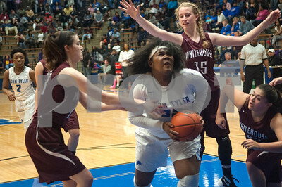 John Tyler's Brea Criss keeps the rebound as they play Whitehouse at John Tyler High School Friday night Jan. 29, 2016.  (Sarah A. Miller/Tyler Morning Telegraph)