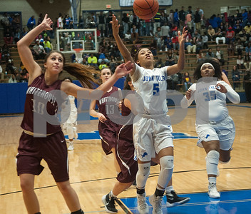 John Tyler's (5) Destini Whitehead reaches for the ball as they play Whitehouse at John Tyler High School Friday night Jan. 29, 2016.  (Sarah A. Miller/Tyler Morning Telegraph)