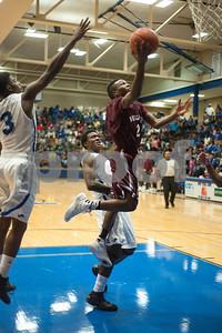 Whitehorse's (2) Javier Neal jumps past JT's Jacob Owens-Nush to make a basket during their game against the Lions at John Tyler High School Friday night Jan. 29, 2016.  (Sarah A. Miller/Tyler Morning Telegraph)