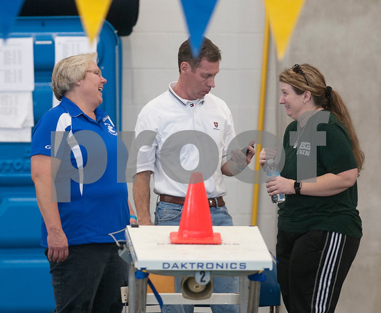 Grace Community School swim coach Janet Taylor, Brook Hill swim coach Kerry Bickerstaff and Bishop Thomas K. Gorman's coach Heather Roberts talk during warm ups before the TAPPS North Region Championships Friday Jan. 29, 2016 held at Mansfield ISD Natatorium.  (Sarah A. Miller/Tyler Morning Telegraph)
