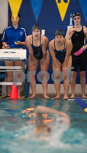 Grace Community School sophomore Kelsey Conner and senior Tiffany Lim cheer on teammate senior Cassandra Smith during the TAPPS North Region Championships Friday Jan. 29, 2016 held at Mansfield ISD Natatorium.  (Sarah A. Miller/Tyler Morning Telegraph)