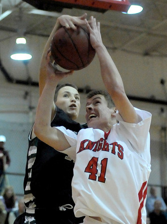 Fairview's Alec Pronk (right) is fouled by Fossil Ridge's Evan Smith (left) during their basketball game at Fairview High School in Boulder, Colorado January 31, 2012.  CAMERA/MARK LEFFINGWELL