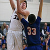 Rocky River's Joey Coffman turns and shoots over Bay's Christian Dupps during the second quarter. Randy Meyers -- The Morning Journal