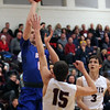 Bay guard Max Showalter shoots and scores over Noah Steele of Rocky River during the first quarter. Randy Meyers -- The Morning Journal