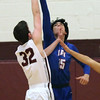 Bay's RJ Sunahara blocks the shot by Joey Coffman of Rocky River during the second quarter. Randy Meyers -- The Morning Journal