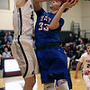 Bay's Christian Dupps is fouled and scores over Joey Coffman of Rocky River during the third quarter. Randy Meyers -- The Morning Journal
