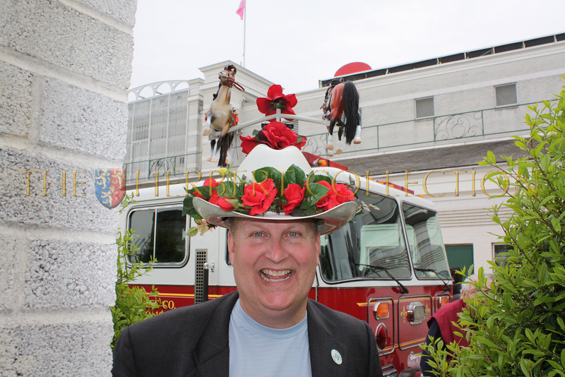 Man wearing a revolving Merry Go Round hat
