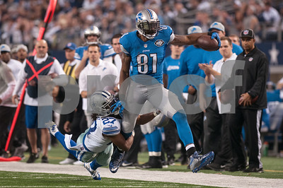 photo by Sarah A. Miller/ Tyler Morning Telegraph   Dallas Cowboys' J.J. Wilcox (27) tackles Detroit Lions player Calvin Johnson (81) Sunday Jan. 4, 2015 during their game at AT&T Stadium in Arlington, Texas. The Cowboys beat the Detroit Lions, 24-20.