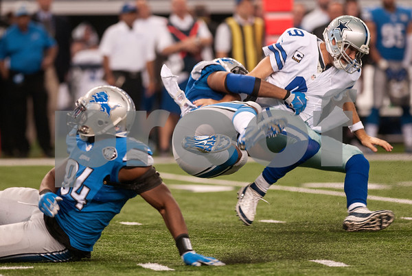 photo by Sarah A. Miller/ Tyler Morning Telegraph  Detroit Lions' defensive end Darryl Tapp (52) tackles Dallas Cowboys' quarterback Tony Romo in the first half of their football game Sunday Jan. 4, 2015 at AT&T Stadium in Arlington, Texas. The Cowboys beat the Detroit Lions, 24-20.