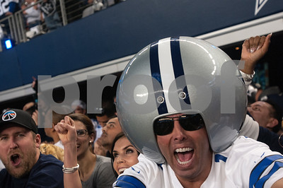 photo by Sarah A. Miller/ Tyler Morning Telegraph   Dallas Cowboys fans cheer in the fourth quarter of their football game against the Detroit Lions Sunday Jan. 4, 2015 during their game at AT&T Stadium in Arlington, Texas. The Cowboys beat the Detroit Lions, 24-20.
