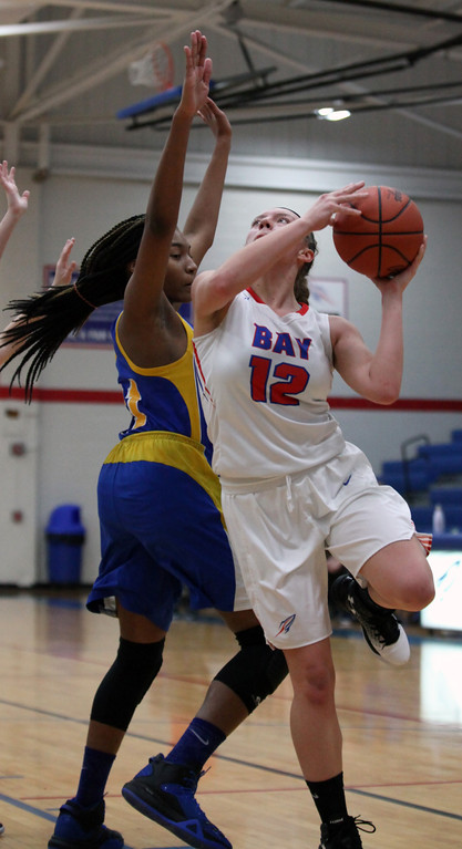 . Bay\'s Maddie Edgerly turns and shoots over Amaya Staton of Lake Ridge during the second quarter. Randy Meyers -- The Morning Journal