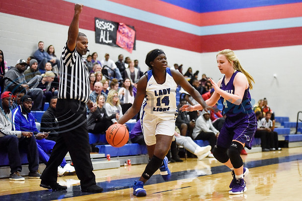 John Tyler's Asia Parker (14) dribbles the ball as Hallsville's Abby Dunagan (4) guards her during a high school basketball game at Boulter Middle School in Tyler, Texas, on Friday, Jan. 4, 2019. (Chelsea Purgahn/Tyler Morning Telegraph)
