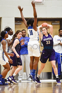 John Tyler's Keirstyn Ross (10) jumps to block Hallsville's Catherine Worford's (33) shot during a high school basketball game at Boulter Middle School in Tyler, Texas, on Friday, Jan. 4, 2019. (Chelsea Purgahn/Tyler Morning Telegraph)