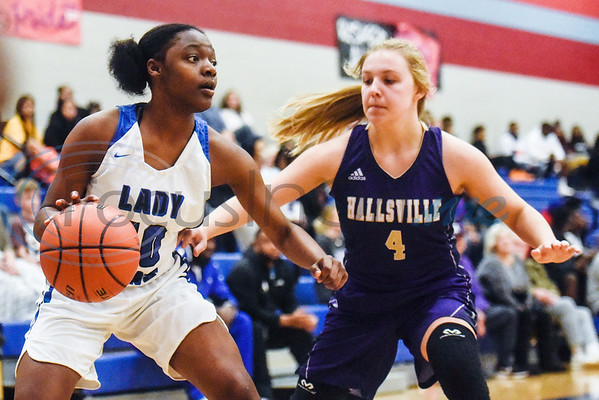 John Tyler's Keirstyn Ross (10) dribbles the ball as Hallsville's Abby Dunagan (4) guards her during a high school basketball game at Boulter Middle School in Tyler, Texas, on Friday, Jan. 4, 2019. (Chelsea Purgahn/Tyler Morning Telegraph)