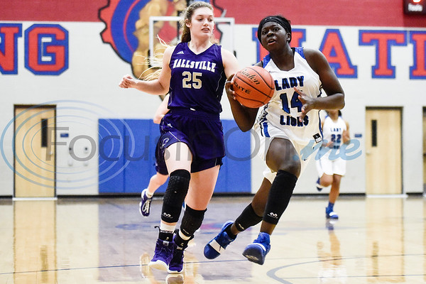 Hallsville's Maddie Ford (25) runs after John Tyler's Asia Parker (14) during a high school basketball game at Boulter Middle School in Tyler, Texas, on Friday, Jan. 4, 2019. (Chelsea Purgahn/Tyler Morning Telegraph)