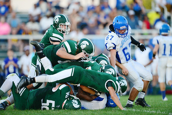 Laurel's defense piles on Union's ball carrier in the first half of the game.