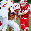 Neshannock's Greg Fornataro assists in taking down the ball carrier.